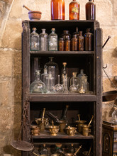 Shelf With Old And Antique Bot...