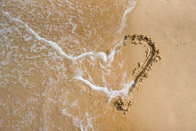 A Heart On The Sand Is Washed ...