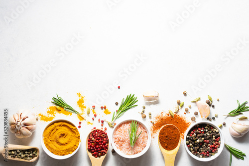 Bright aromatic set of spices on white marble table top view with copy space for your text Fototapet