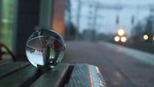 Crystal Ball On A Bench Reflec...