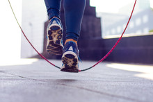 Close Up Of An Athletic Person's Feet Jumping Rope Outdoor