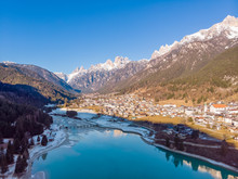 The View Of Auronzo And The Frozen Lake Santa Katerina, Dolomites, Italy. Drone Aerial Photo