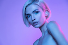 Beautiful European Blond Woman Trendy Glowing Neon Nude Headshot Art Studio Portrait. High Fashion Stylish Image With Attractive Girl In Colorful Fashionable Light. Perfect Female Young Face