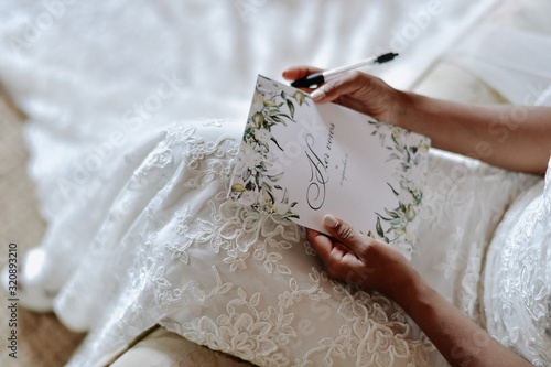 Bride is writing the wedding vows , wedding day symbols Canvas Print