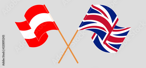 Crossed and waving flags of Austria and the UK Wallpaper Mural