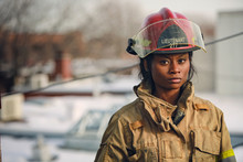 Women Firefighter With Red Hel...