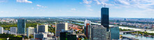 Stunning Aerial Panoramic Cityscape View Austrian Capital City Of Vienna. Modern Glass-concrete Skyscrapers In Donau City On Danube - Of The Largest River In Europe. Hot Summer Day.