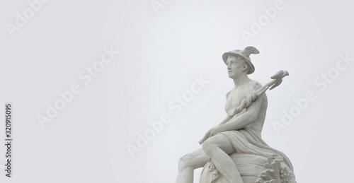 Fototapeta Ancient statue of god of commerce, merchants and travelers Hermes (Mercury) against gray background