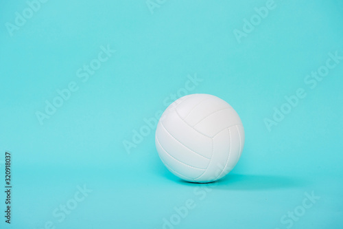 Volleyball ball isolated on blue background.