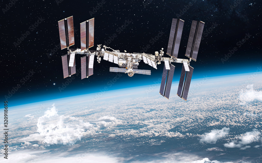Fototapeta International space station on orbit of the Earth planet. ISS in the outer dark space. Elements of this image furnished by NASA