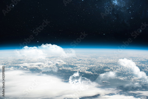 Tela Orbit of planet Earth with sky and clouds in outer space