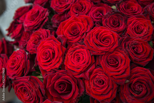 Red roses background. Bouquet for Valentine's Day. Close-up of a beautiful bouquet of red roses. #320929869
