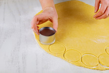 Woman Cuts Rolled Dough For Ba...