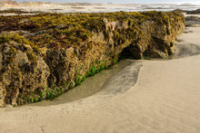 Large Rocky Outcropping On Sandy Beach