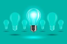 Illuminated Light Bulb On Gree...