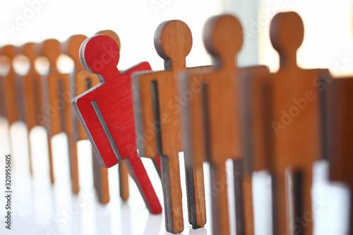 Cuadros en Lienzo Male red plastic toy businessman silhouette wooden figure background closeup