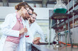 Leinwanddruck Bild Group of scientists working in the laboratory