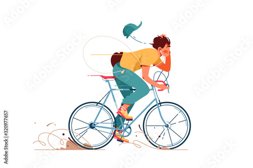 Fototapeta Young man rides sport bicycle listening to music obraz
