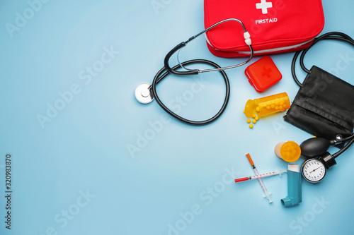 Fotografie, Obraz First aid kit on color background