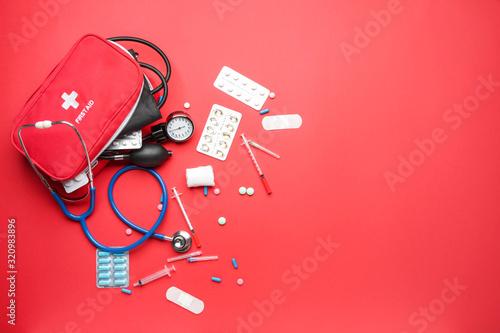 Obraz na plátně First aid kit on color background