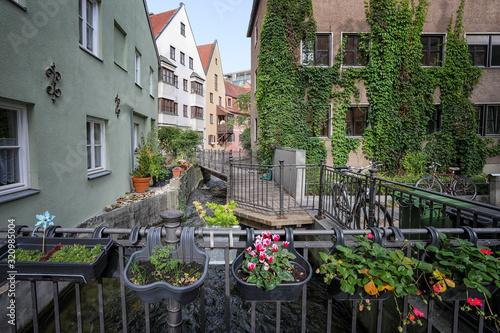 Stadtbummel durch die Altstadt von Augsburg mit Brücke über einen der vielen Kan Canvas Print