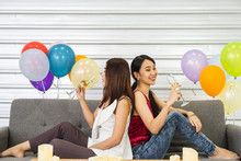 Two Young Asian Girls Siting O...