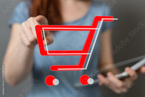 Fototapeta Shopping cart on digital tablet. Shopping online concept.. obraz