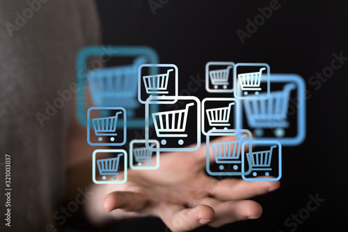 Fototapeta Online shopping business concept selecting shopping cart. obraz