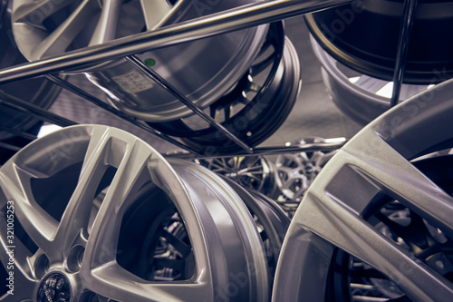 Alloy car wheels in a store Canvas Print