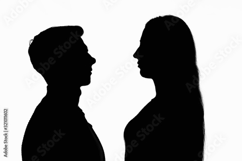 Fototapeta Contour portrait of two people looking at each other obraz