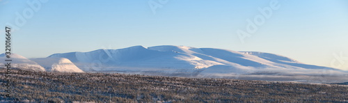 Winter panorama of the Khibiny mountains from the city of Apatity Canvas Print