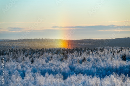Winter snow rainbow (halo) in Polar Russia. Canvas Print