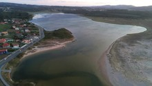 Aerial Of  Beautiful Lagoon Of A Frouxeira And The Small Spanish Town Valdovinos