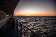 Board The Ship With A Sunset A...
