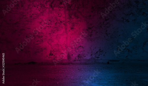 Dark abstract background. Background of an old concrete wall illuminated by a blue and pink neon spotlight