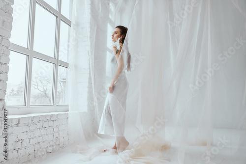 Obraz Portrait of girl posing in silk dress. - fototapety do salonu