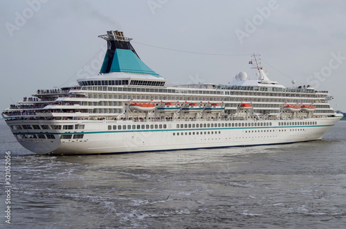 Photo Classic cruise ship or cruise ship liner MS Artania sailing away from port