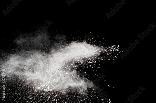Cuadros en Lienzo White powder explosion isolated on black background