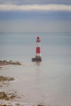 Beachy Head Lighthouse Off The Sussex Coast, With Calm Waters Surrounding