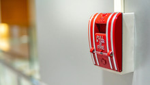 Red Fire Alarm Switch On Concr...