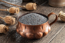 Poppy Seeds In A Cup With Popp...