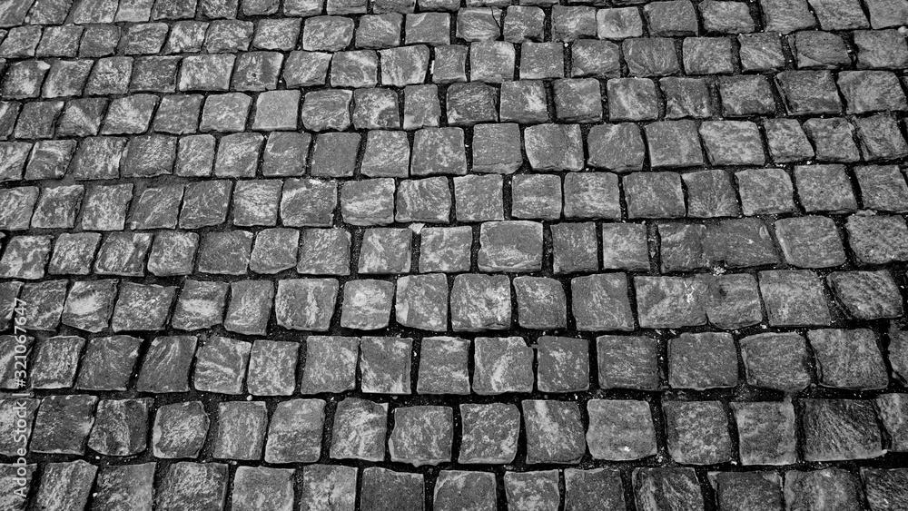 Fototapeta Street granite cobblestone sidewalk cubic stone close up wallpaper