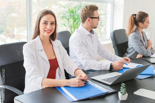 Fototapeta Young businesswoman during meeting in office obraz na płótnie