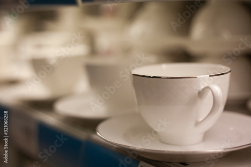 white porcelain cups in a shop