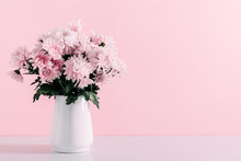 Fresh Bouquet Of Pink Flowers In Vase On White Shelf On Pink Wall Background. Valentines Day, Easter, 8th March, Mother Day Background. Floral Home Decor.