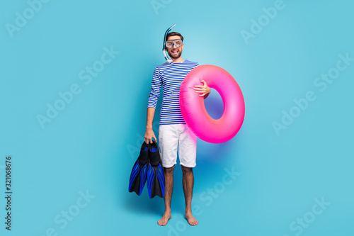 Full body photo of funny excited guy tourist swimmer hold underwater mask breath Canvas Print