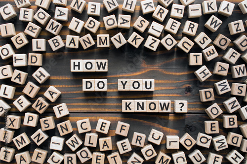 Obraz How do you know? - phrase from wooden blocks with letters, how do you know concept, random letters around, wooden background - fototapety do salonu