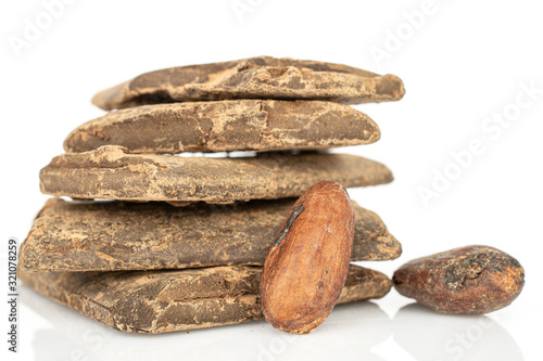 Two whole fresh brown cocoa beans with cocoa butter bars isolated on white backg Wallpaper Mural