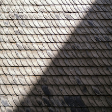 Slate Roof Half In Sun And Half In Shade