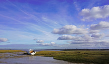 Small Boat During The Low Tide, Medway Estuary, Kent, UK